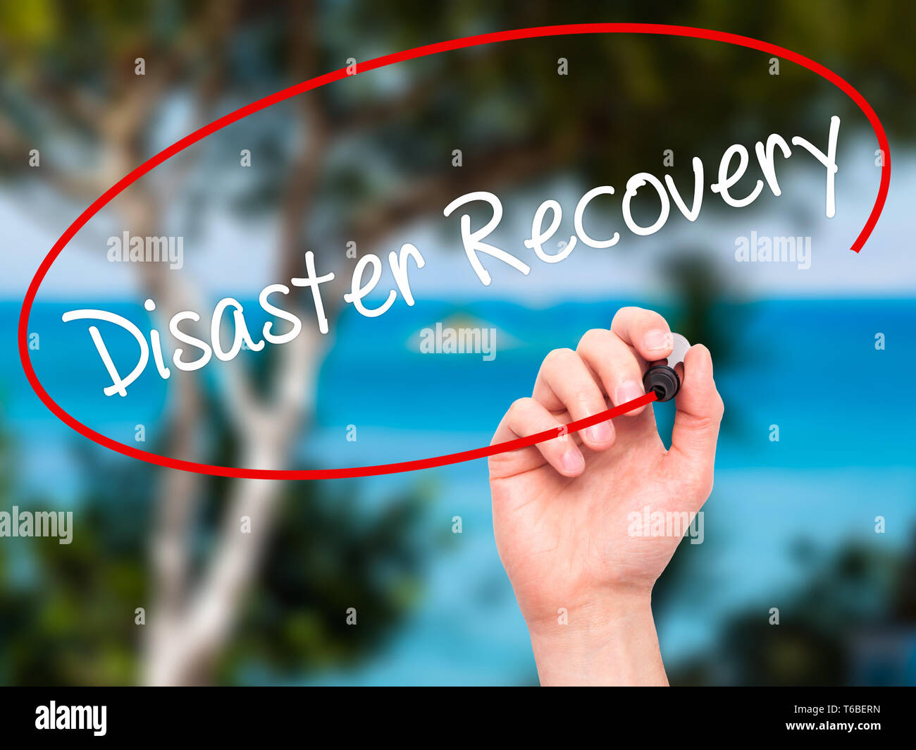 Man Hand writing Disaster Recovery with black marker on visual screen - Stock Image