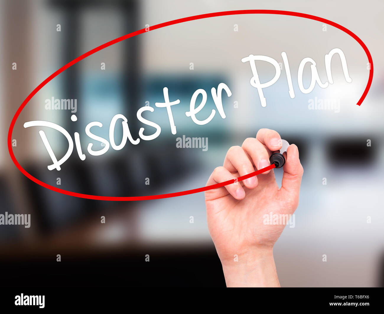 Man Hand writing Disaster Plan with black marker on visual screen - Stock Image