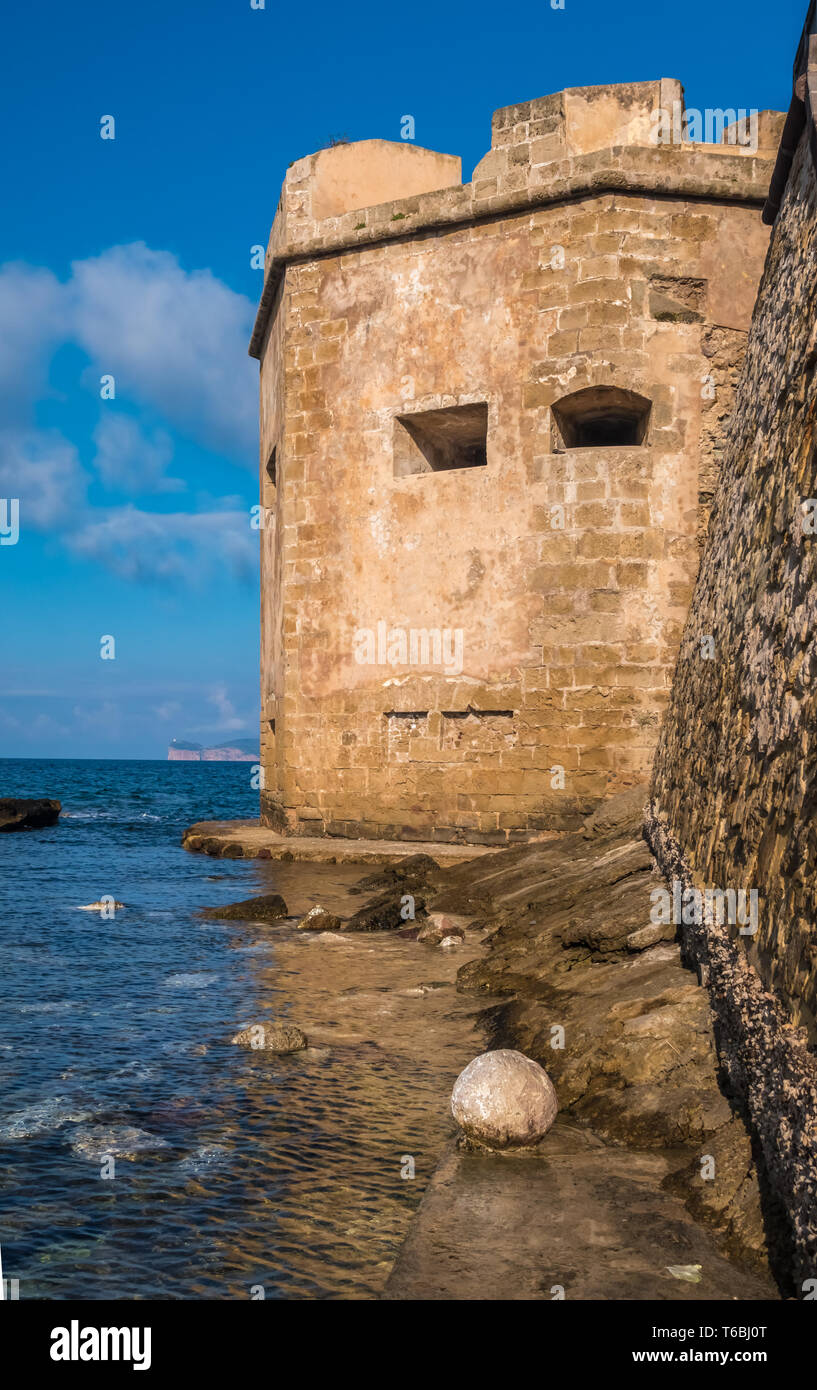 The impressive medieval sea-front ramparts of the city of Alghero (L'Alguer), province of Sassari , northwestern Sardinia, Italy. Built by the Genoese - Stock Image