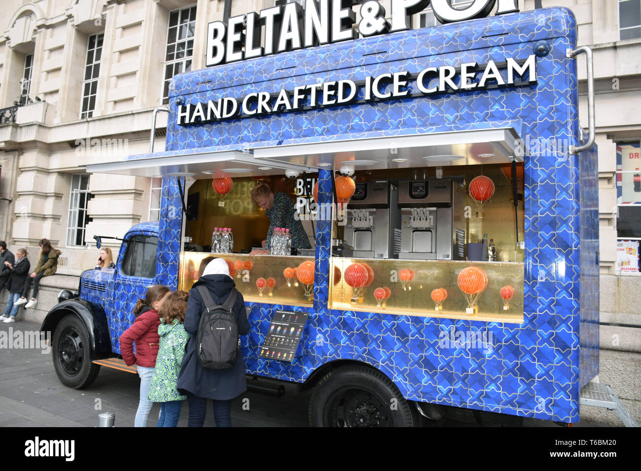 Ice cream van in front of the old County Hall building on the South Bank, London April 2019 UK - Stock Image