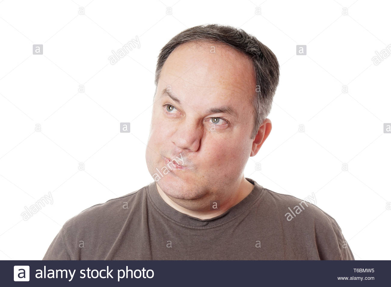 skeptical man twisting his mouth - Stock Image