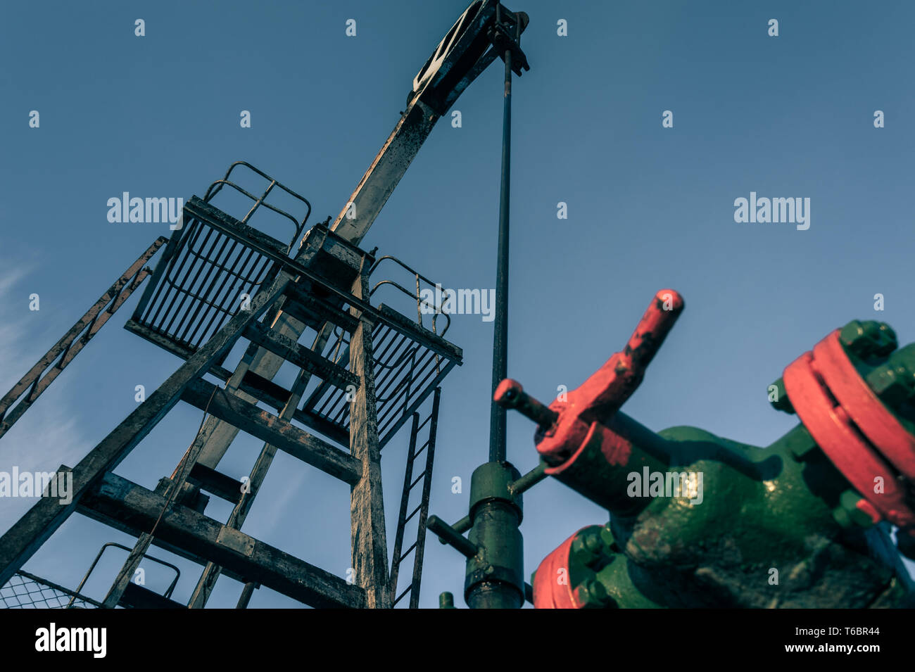 Group of wellhead. Oilfield with sand ground. Stock Photo
