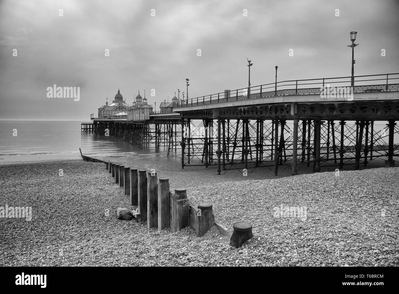 Eastbourne. The promenade and pier at the popular holiday resort of Eastbourne on the East Sussex coast of southeast England - Stock Image