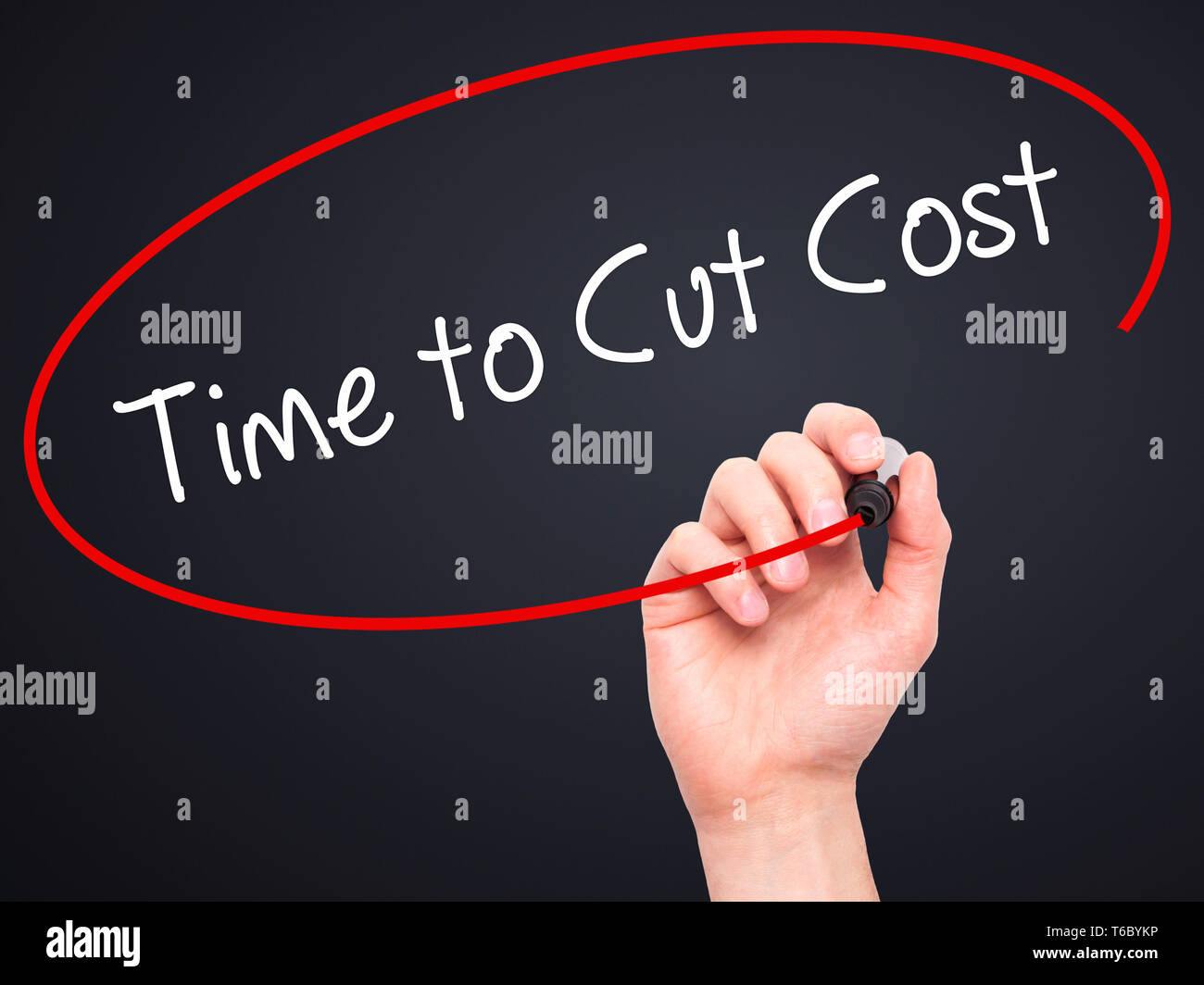 Man Hand writing Time to Cut Cost with black marker on visual screen - Stock Image