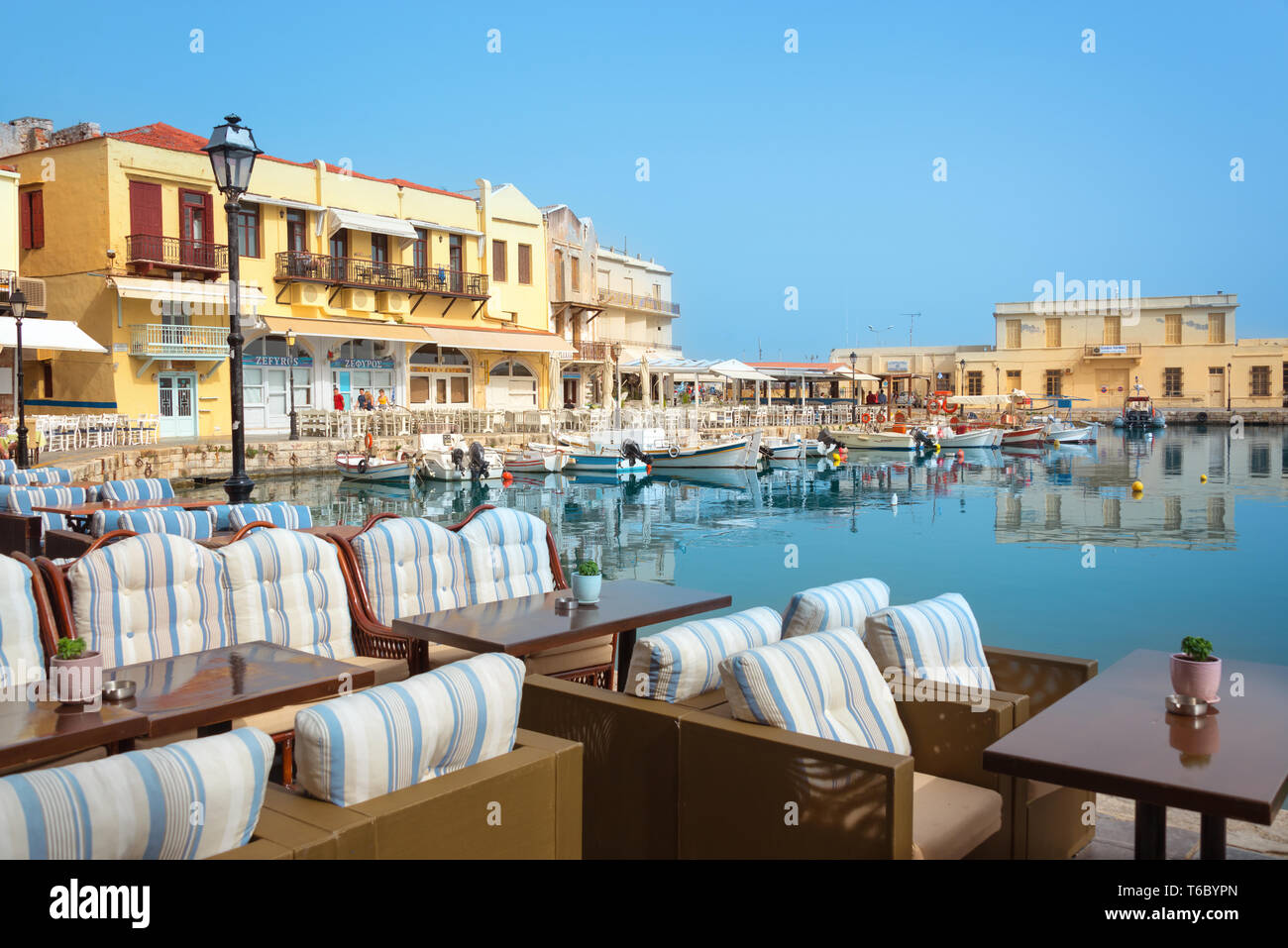 Terrace with view on the harbor of Rethymno in Crete, Greece Stock Photo