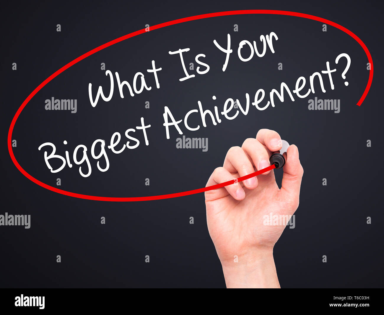 Man Hand writing What Is Your Biggest Achievement? with black marker on visual screen Stock Photo