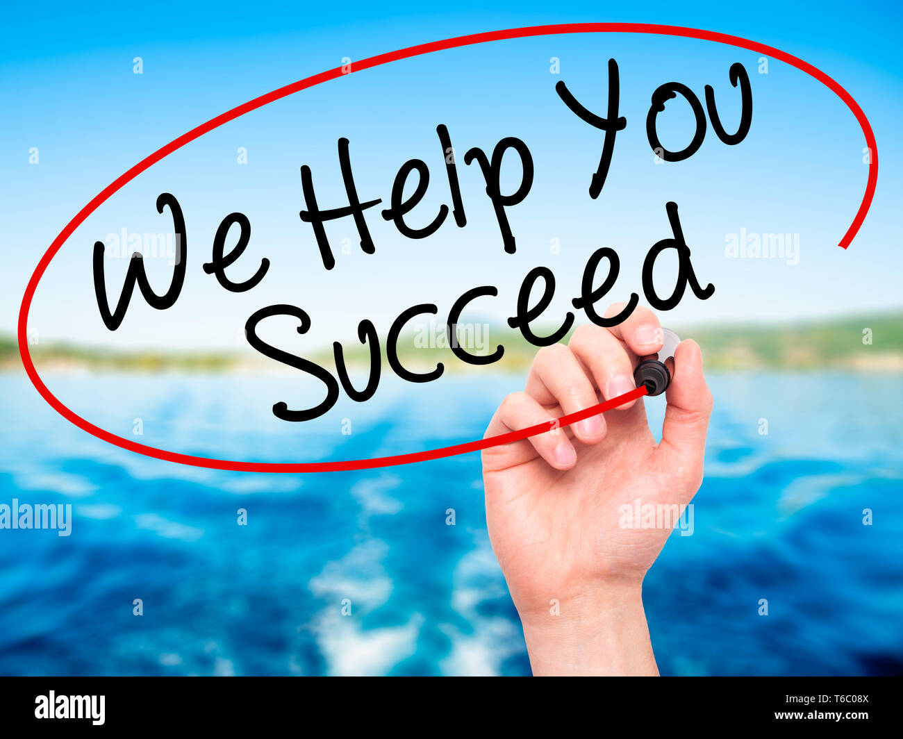 Man Hand writing We Help You Succeed with black marker on visual screen - Stock Image
