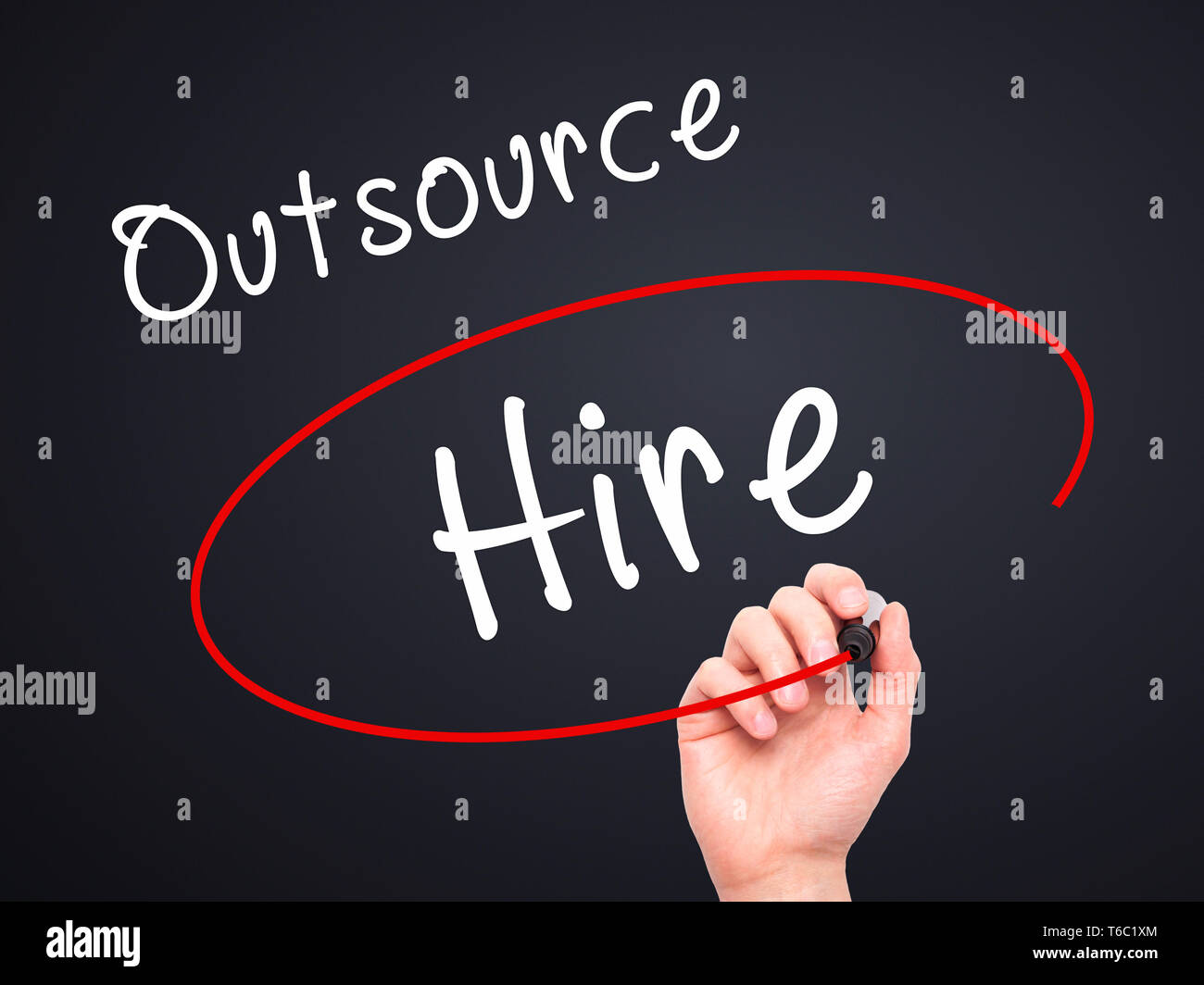 Man Hand writing and Choosing to Hire instead of Outsource with black marker on visual screen - Stock Image