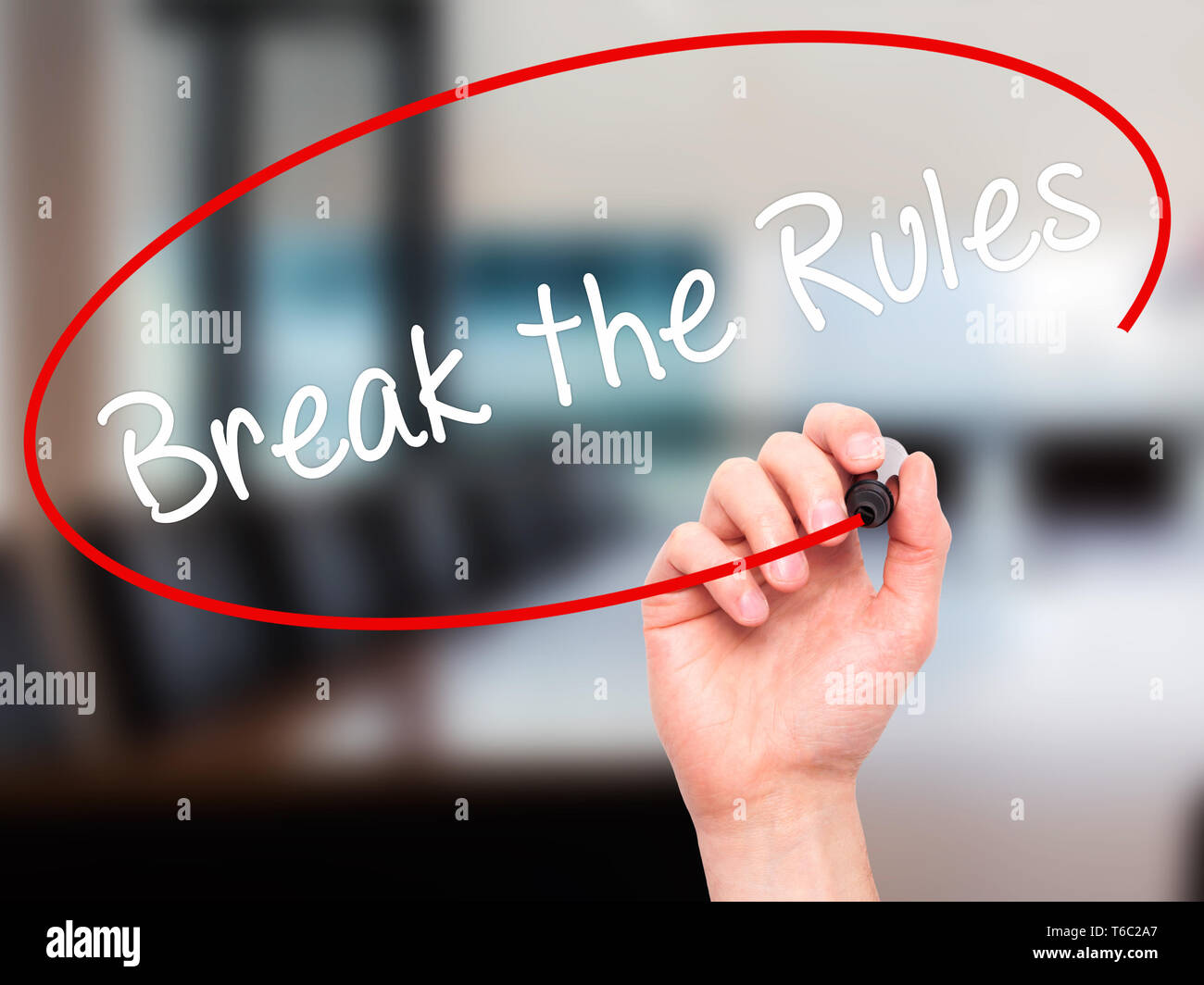 Man Hand writing Break the Rules with black marker on visual screen - Stock Image