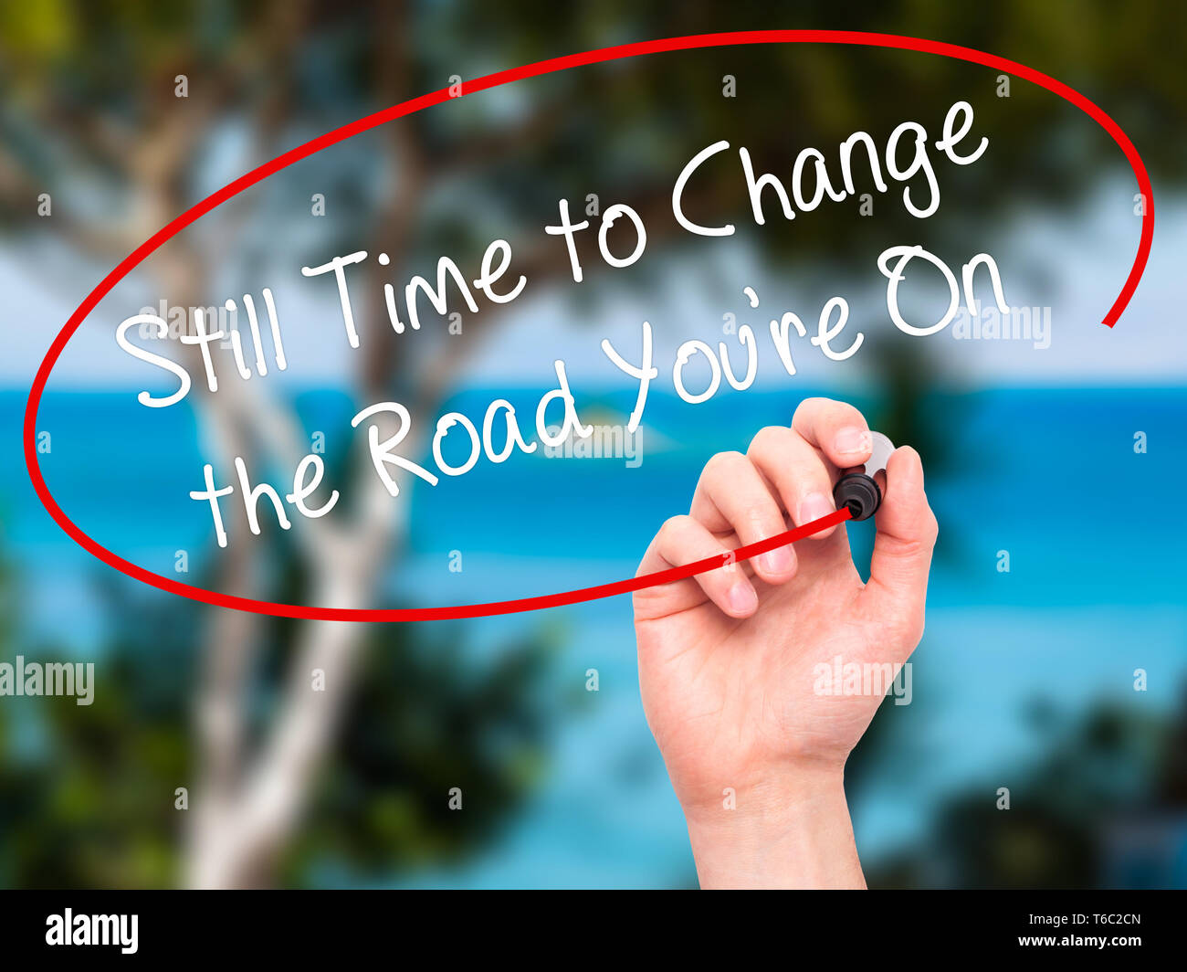 Man Hand writing Still Time to Change the Road You're On with black marker on visual screen - Stock Image