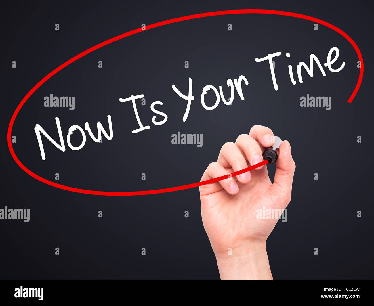 Man Hand writing Now Is Your Time  with black marker on visual screen - Stock Image
