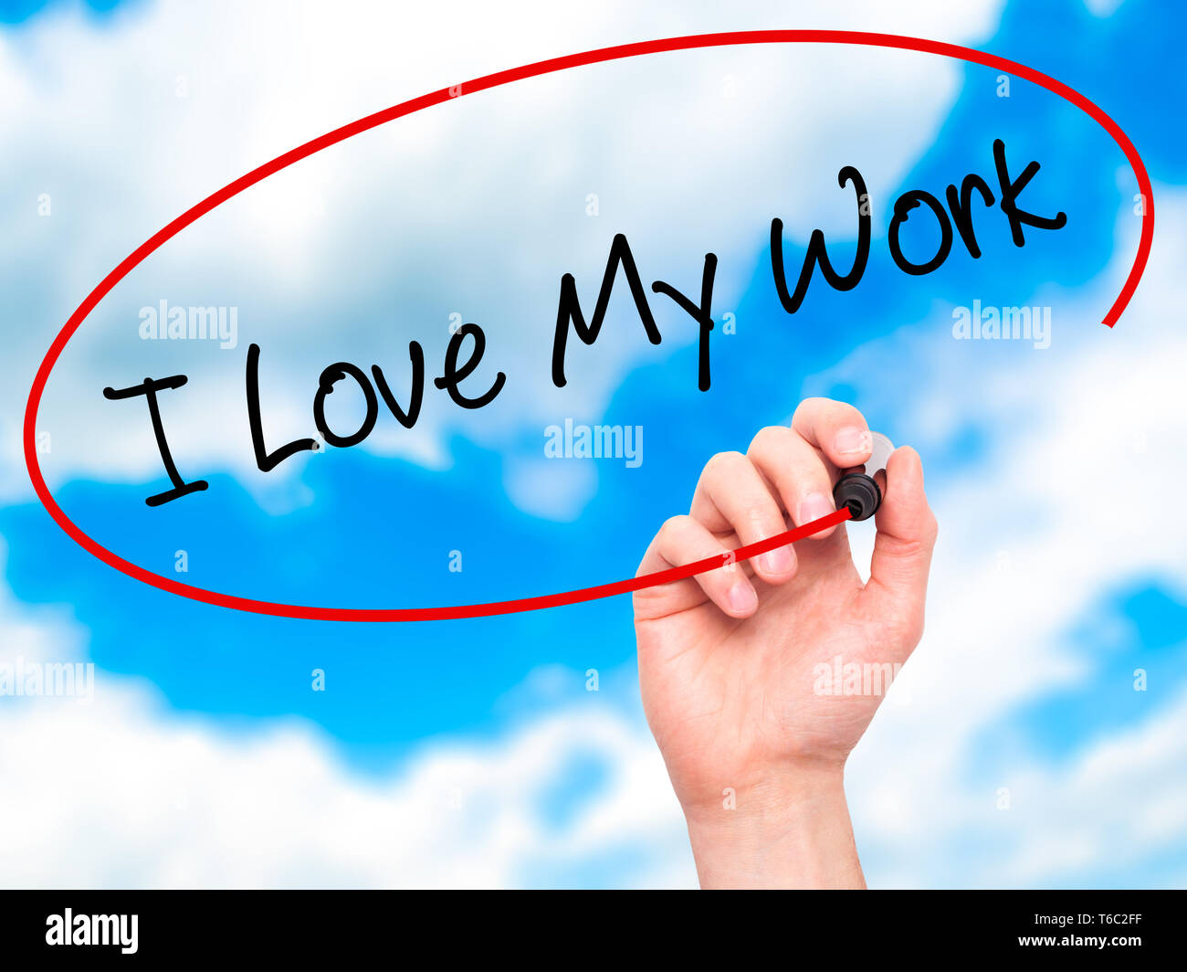 Man Hand writing I Love My Work with black marker on visual screen - Stock Image
