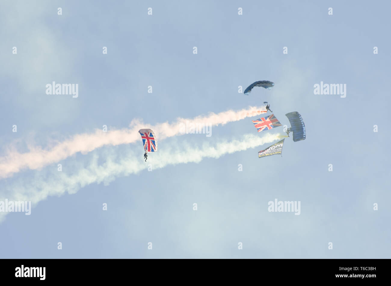 British Army Parachutists descending  over t Clacton free airshow - Stock Image
