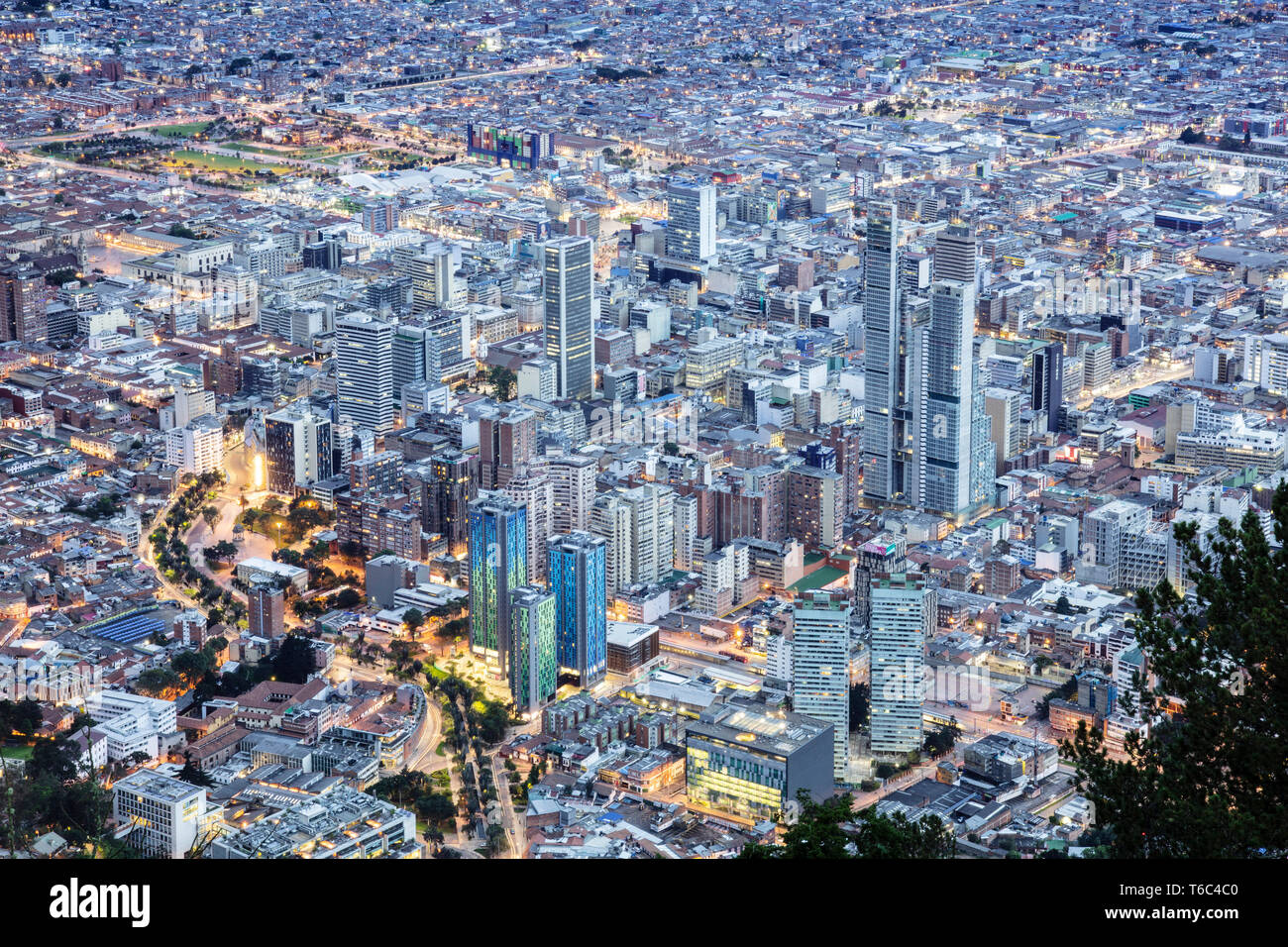 South America, Colombia, Bogota, elevated view of the city centre showing illuminated buildings - Stock Image