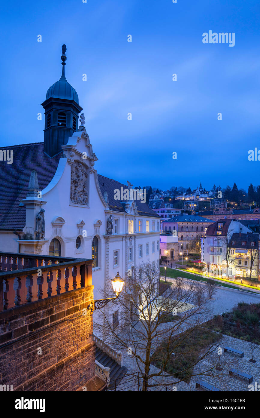 Roman bath ruins and Friedrichsbad (Frederick's bathhouse) at dusk, Baden-Baden, Baden-Württemberg, Germany - Stock Image