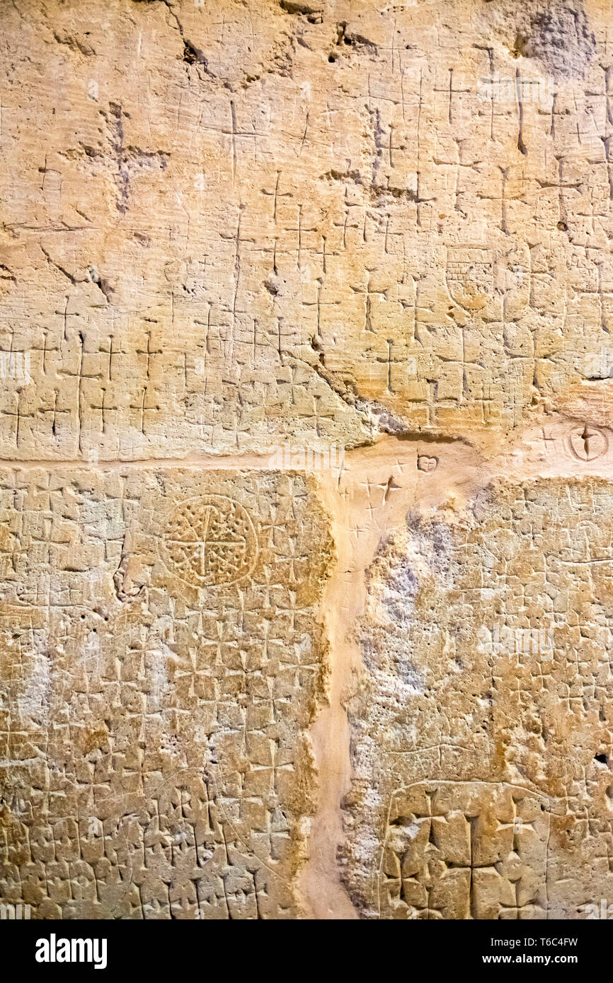 Ancient crosses carved by pilgrims marking the location of Jesus' burial in the caves beneath the Church of the Holy Sepulchre. - Stock Image