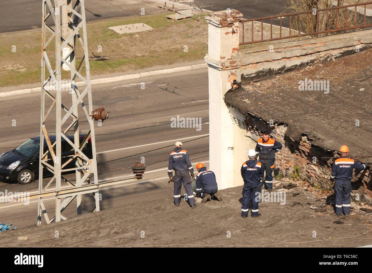 Kremenchug, Poltava region, Ukraine, April 9, 2019, improvement of the city repair of the old roof - Stock Image