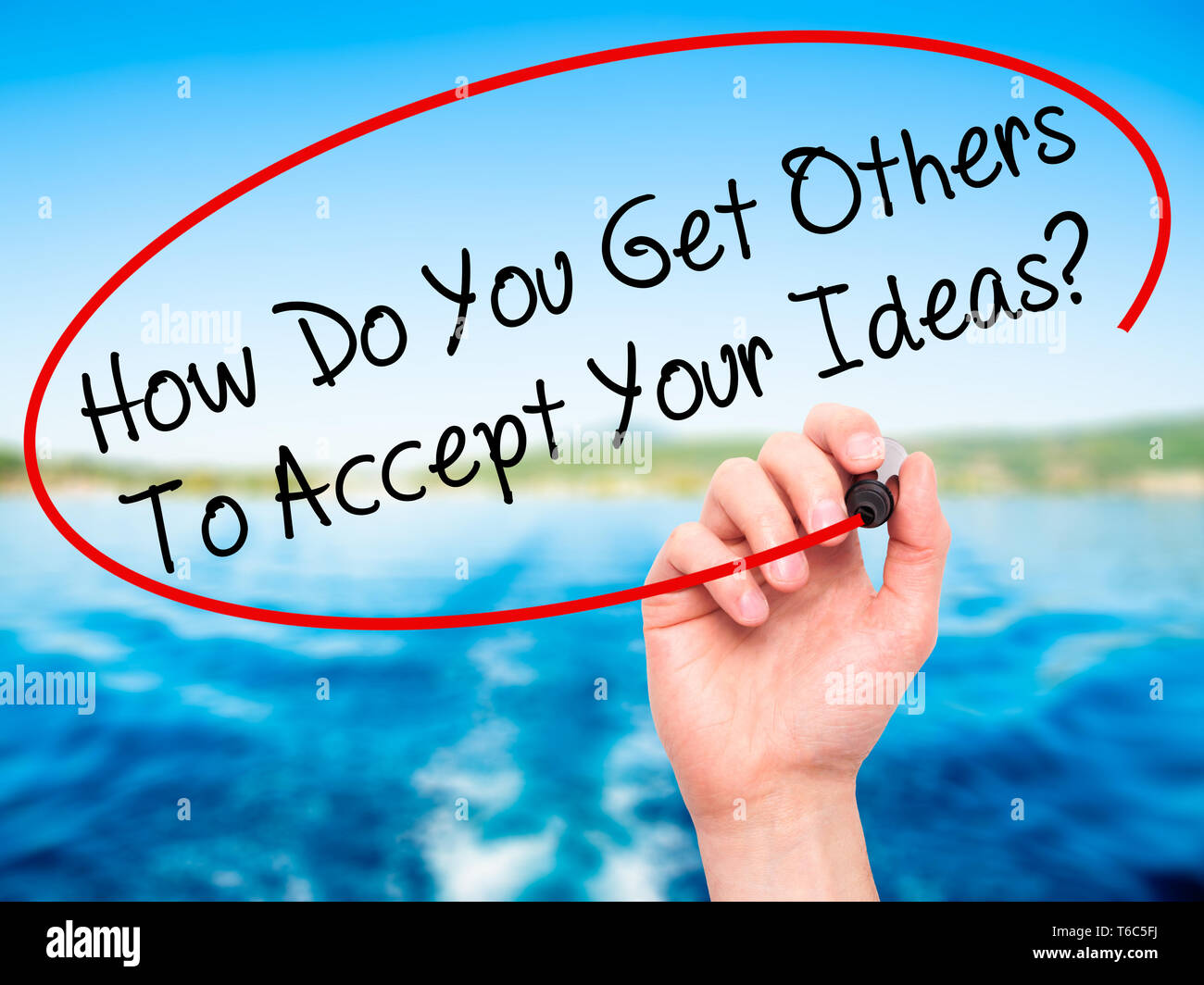 Man Hand writing How Do You Get Others To Accept Your Ideas? with black marker on visual screen - Stock Image