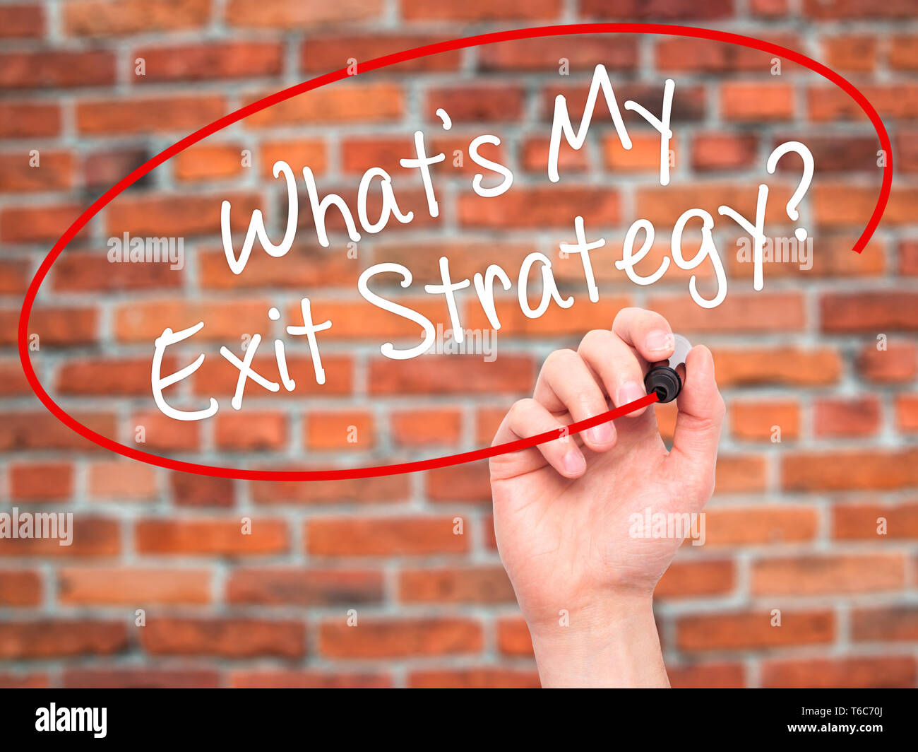 Man Hand writing What's My Exit Strategy? with black marker on visual screen - Stock Image