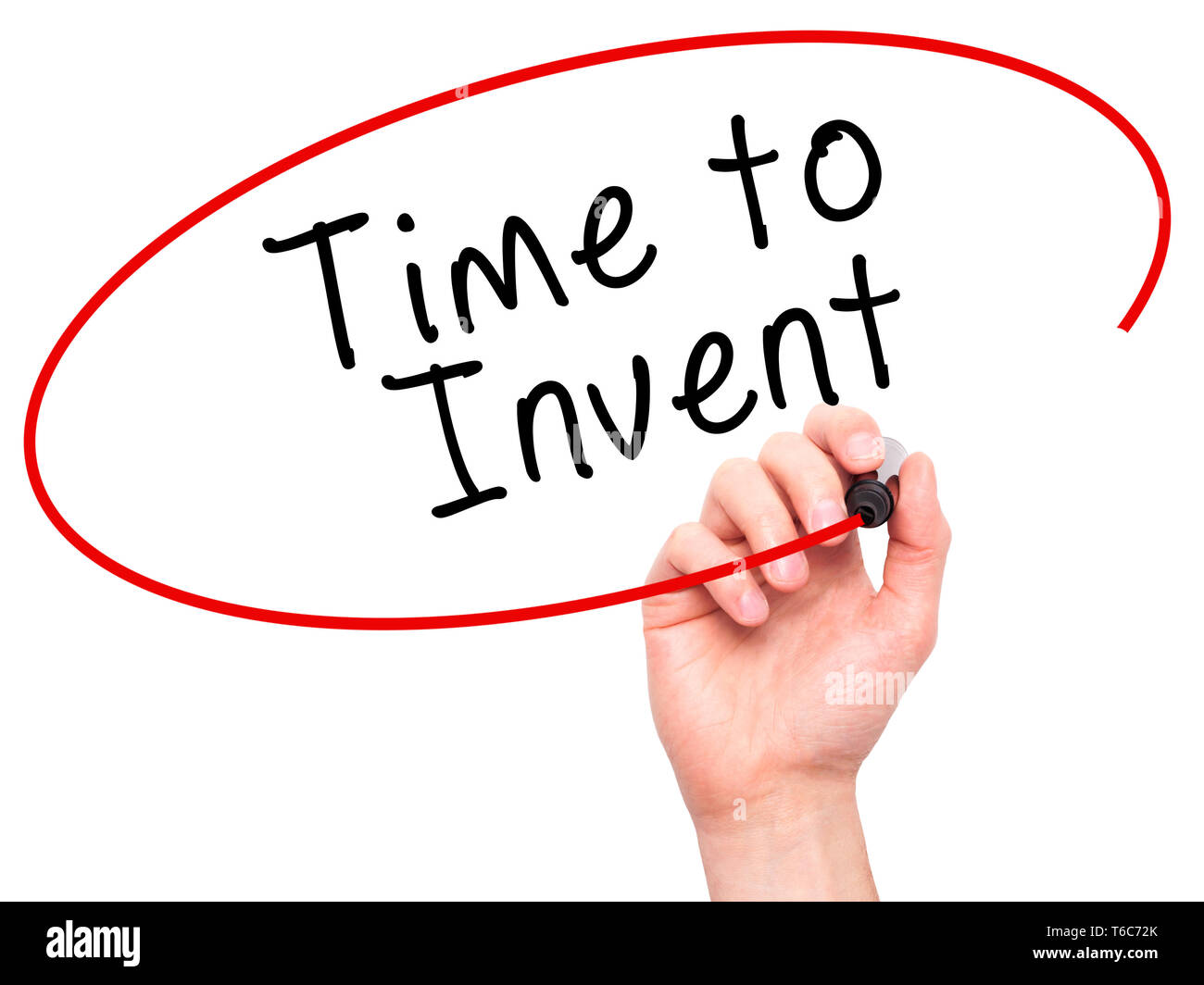 Man Hand writing Time to Invent with black marker on visual screen - Stock Image