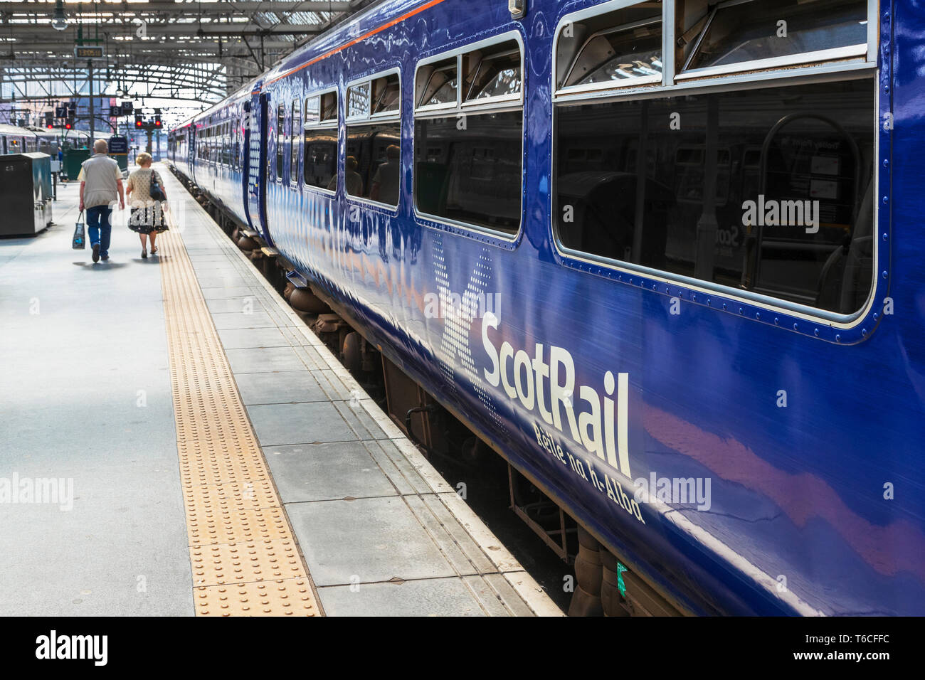Scotrail train at a platform in Glasgow Central railway station, Glasgow, Scotland, UK - Stock Image