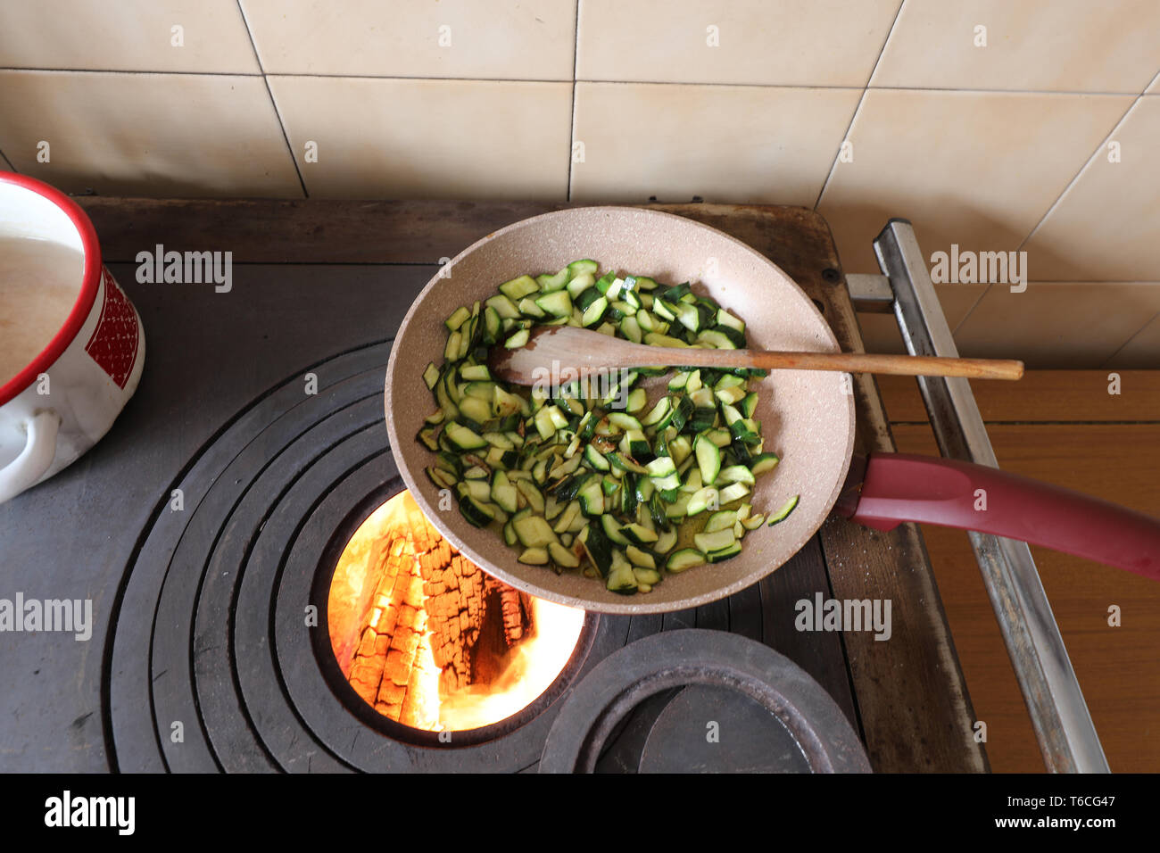 zucchini cooked in a pan on a wood stove in a mountain home - Stock Image