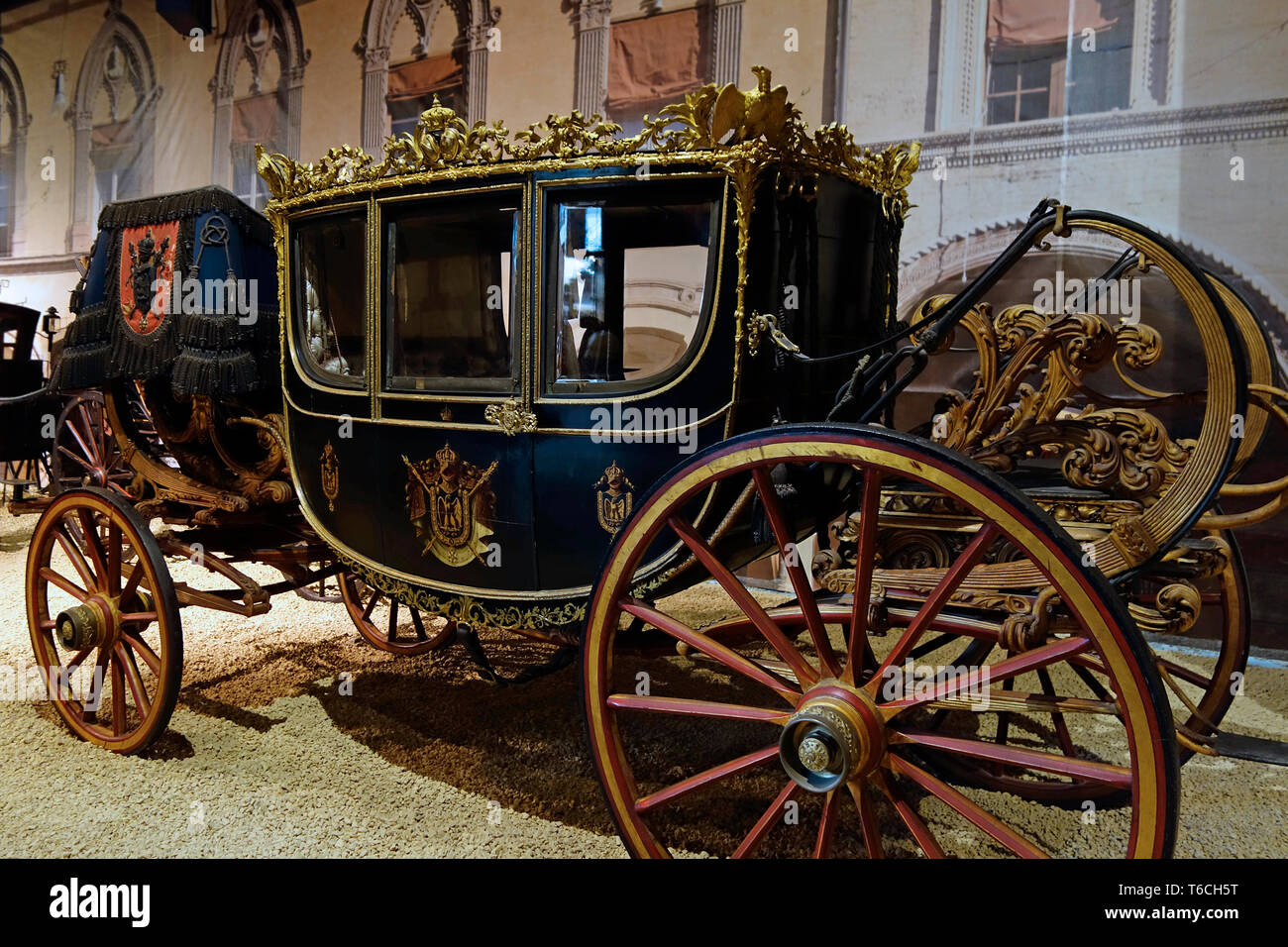 1852 seven-window dress coach / royal carriage / six horse drawn gala berlin coach at Autoworld, vintage vehicle museum in Brussels, Belgium - Stock Image