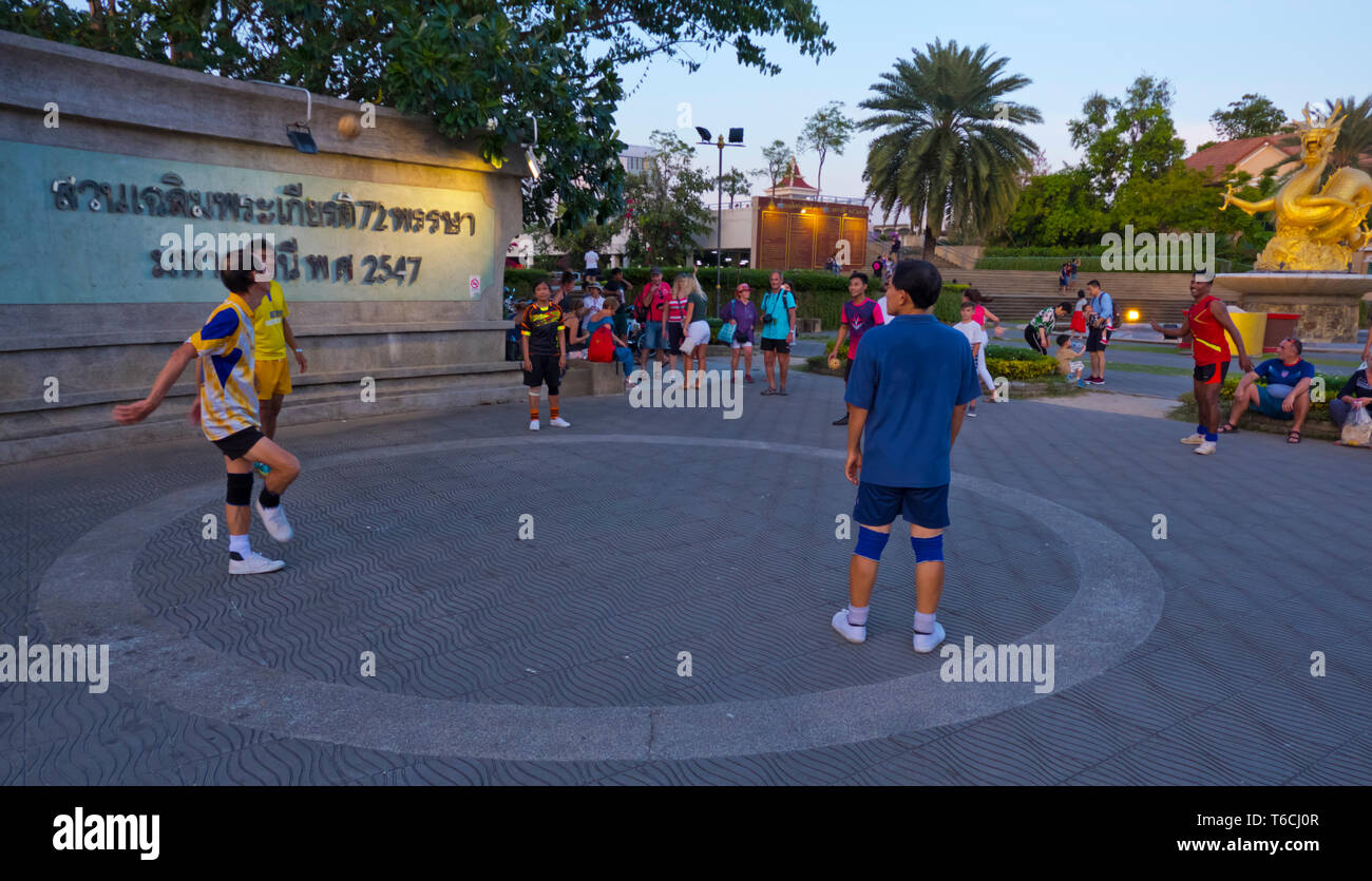 Local people playing takraw, kick volleyball, Phuket town, Thailand - Stock Image