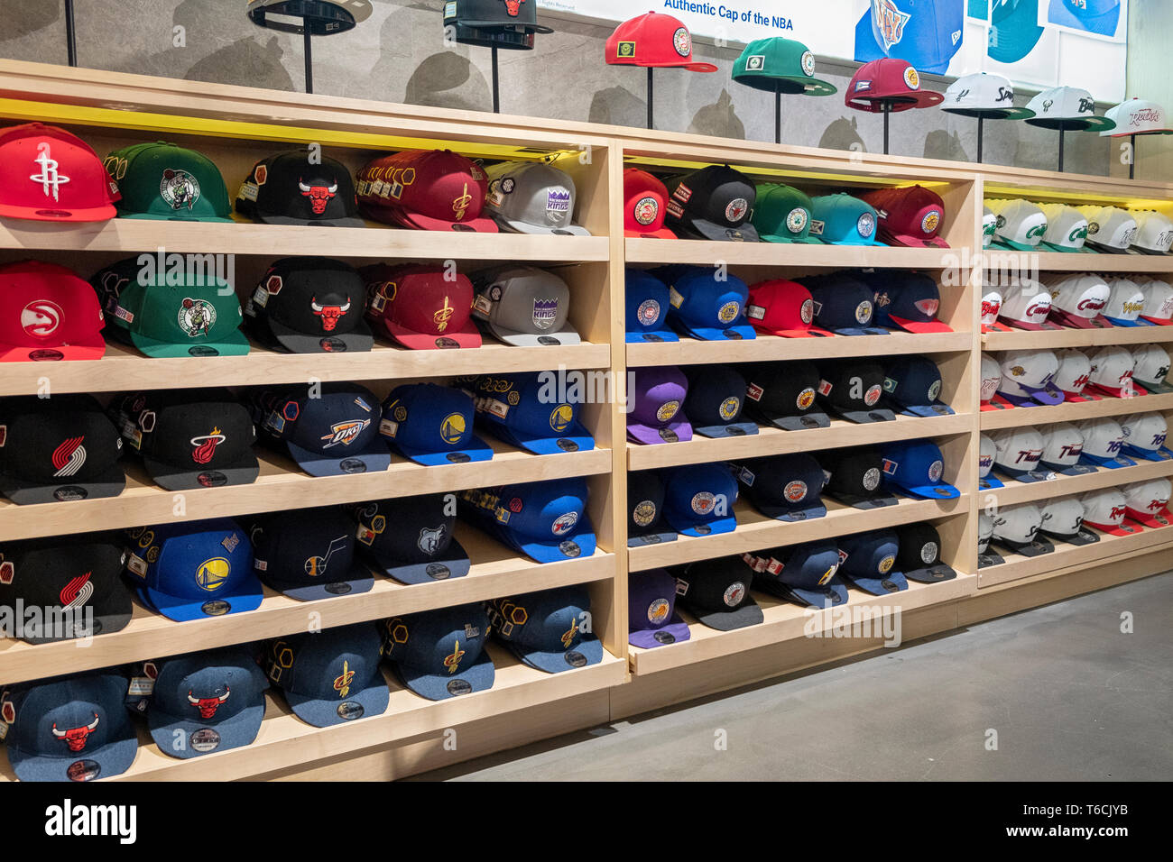 sports shoes 6e845 55955 A wide variety of team caps for sale inside the NBA store on ...