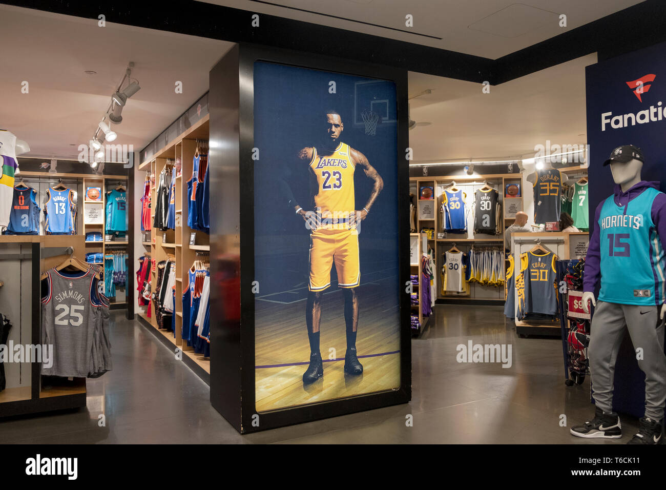 An area in the lower level inside the NBA store on Fifth Ave. in MIdtown, Manhattan, New York City. Showing player replica jerseys for sale. Stock Photo