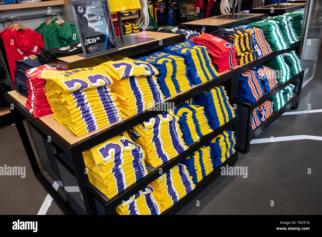 A selection of NBA star players' t shirts for sale inside the NBA store on Fifth Ave. in MIdtown, Manhattan, New York City. Stock Photo