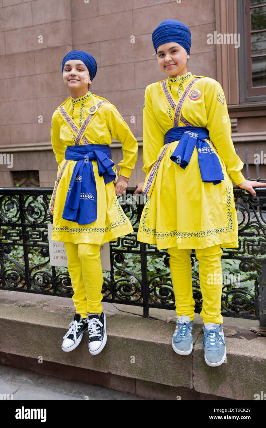 Two teenage Sikh girls in matching costumes prior to the Sikh Day Parade in Manhattan, New York City. Stock Photo