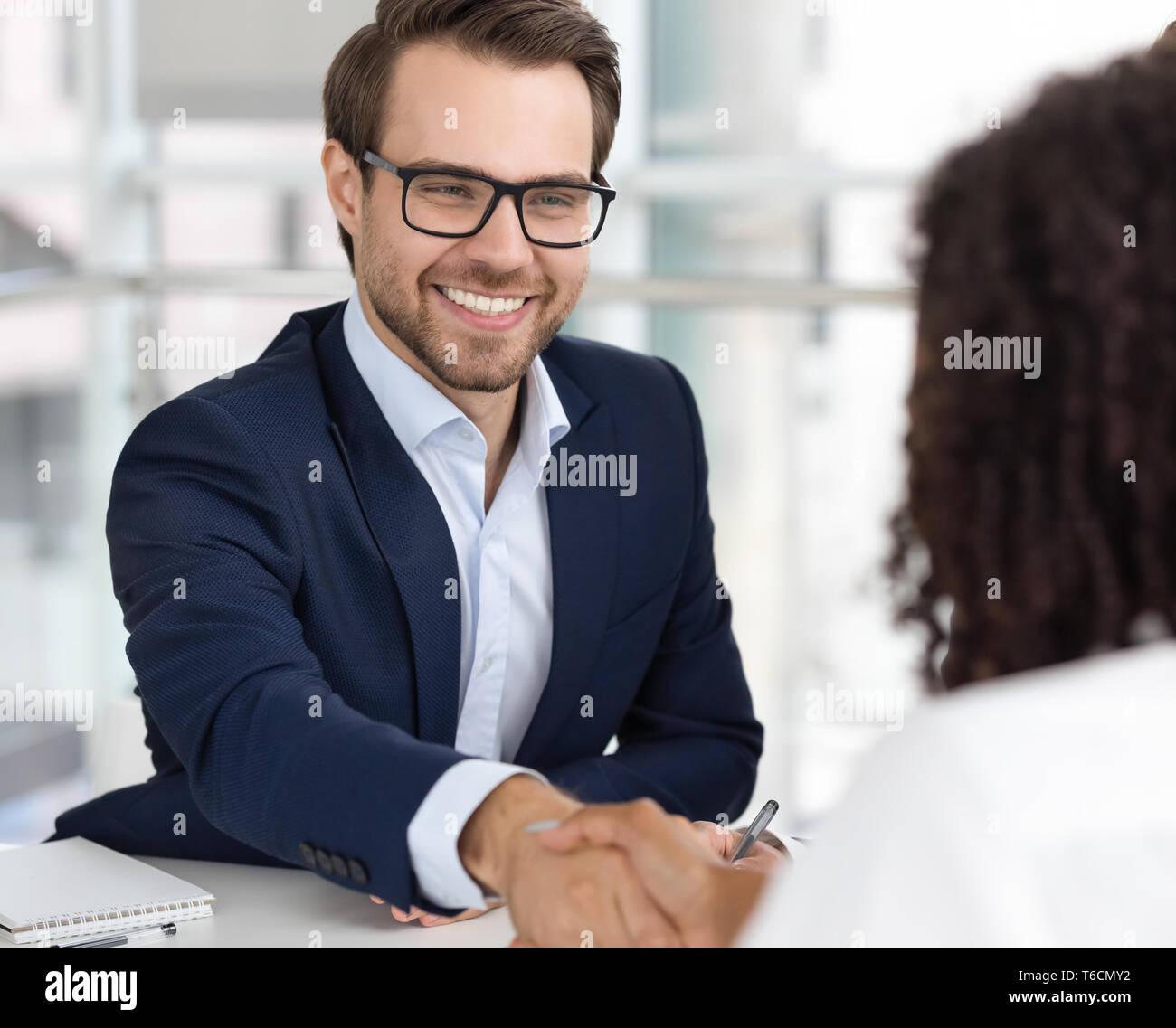 Happy businessman boss hr handshake client candidate make deal hiring - Stock Image