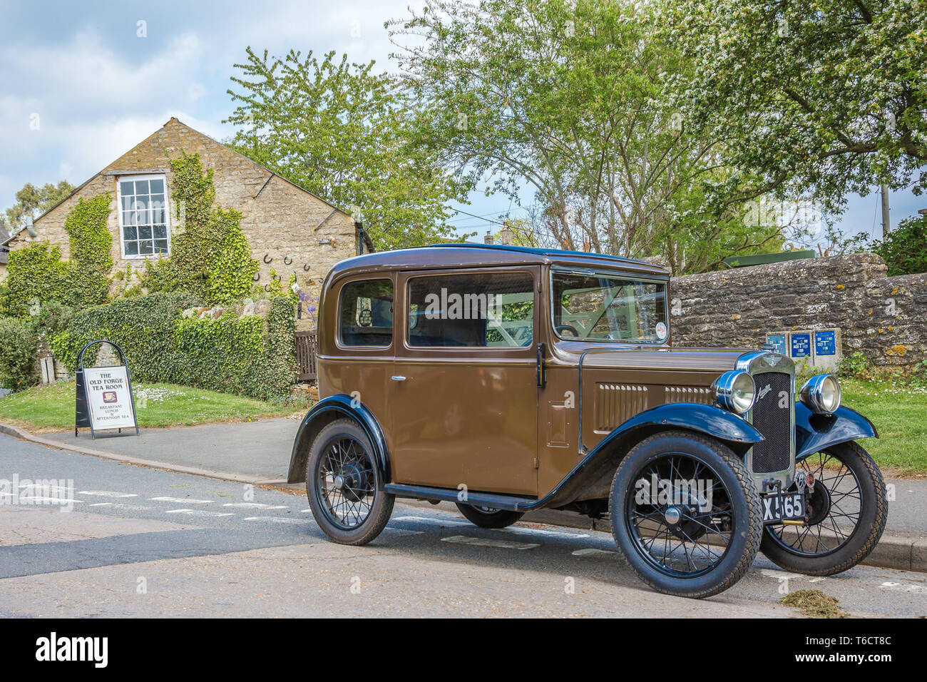 A vintage Austin 7 saloon car in a village location Stock Photo