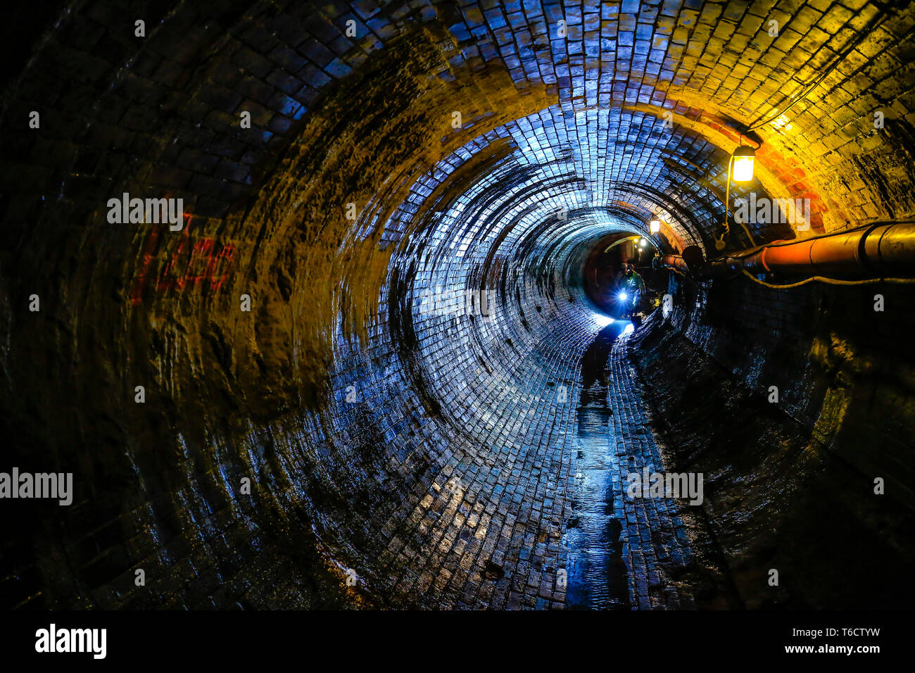Ruhr area, North Rhine-Westphalia, Germany - Topic picture sewer network transmission, inspection of an old, bricked sewer in need of rehabilitation.  - Stock Image