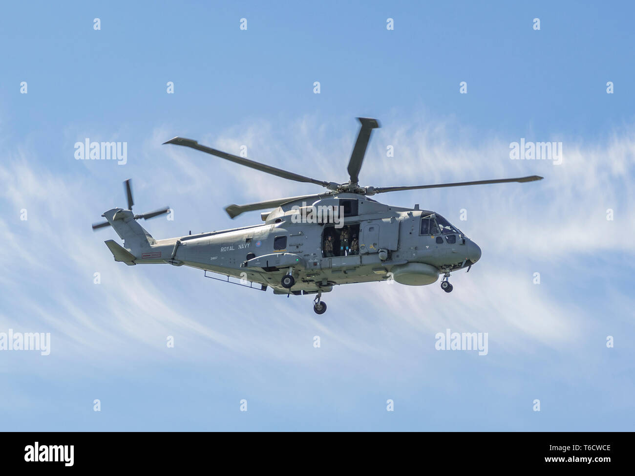 'Tristan' (ZH857), an AgustaWestland AW101 Merlin HM.2 (previously known as EH Industries EH101) Royal Navy helicopter flying low in the UK. - Stock Image