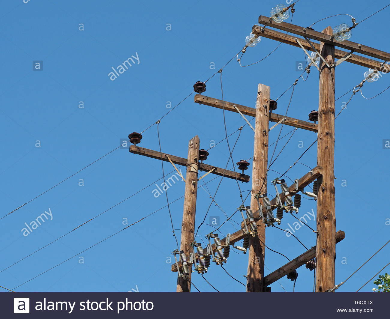 A grid view ,electric current pylon and cables Stock Photo
