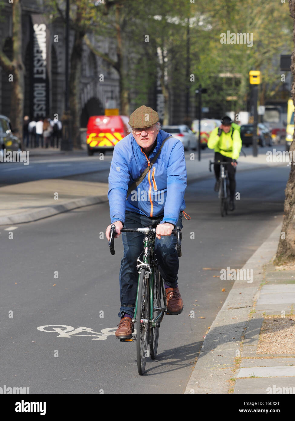 Angry snarling man Cycling in London, England, UK - Stock Image