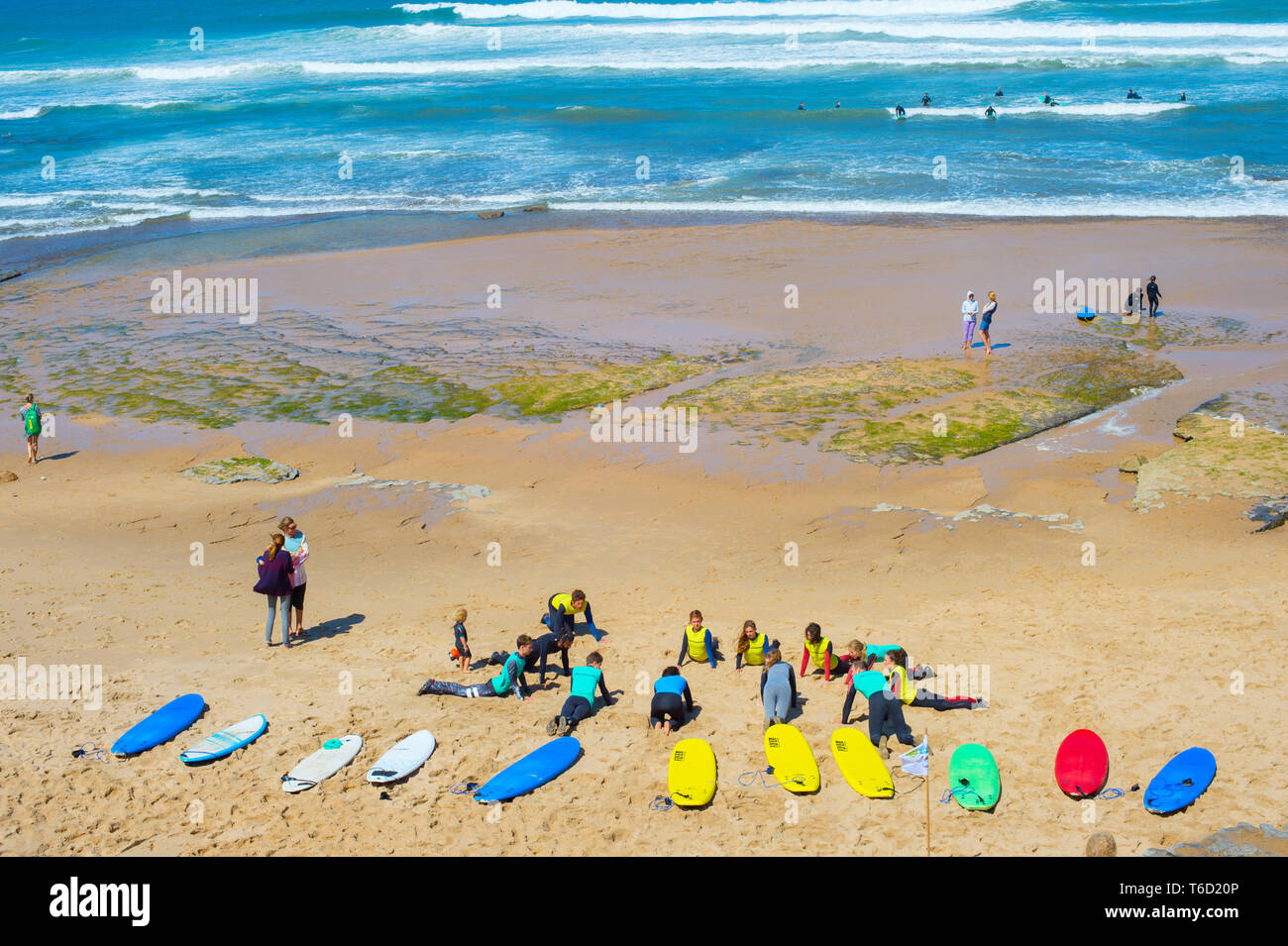 Surf lessons on the beach - Stock Image