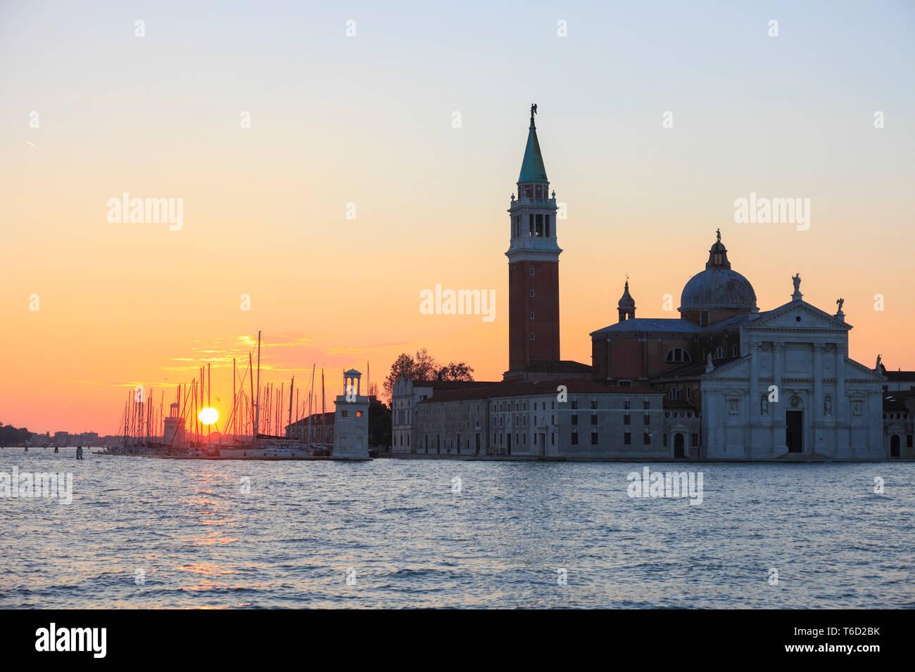Sunrise over the marina Compagnia della Vela und Isola San Giorgio, Venice, Veneto, Italy. - Stock Image