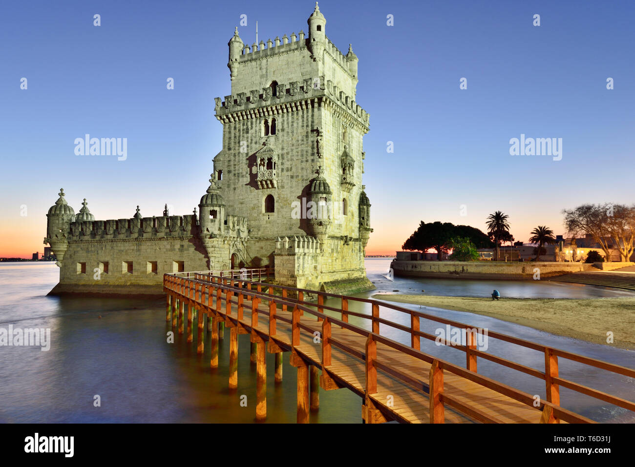 Torre de Belem (Belem Tower), in the Tagus river, a UNESCO World Heritage Site built in the 16th century in Portuguese Manueline Style at twilight. - Stock Image
