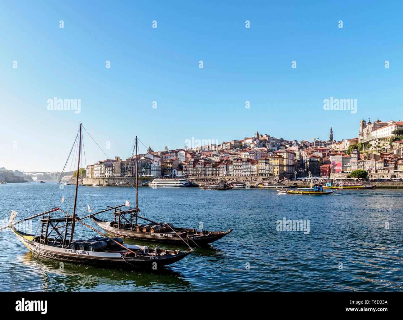 Traditional boats on Vila Nova de Gaia bank of Douro River, Porto Skyline in the background, Portugal Stock Photo
