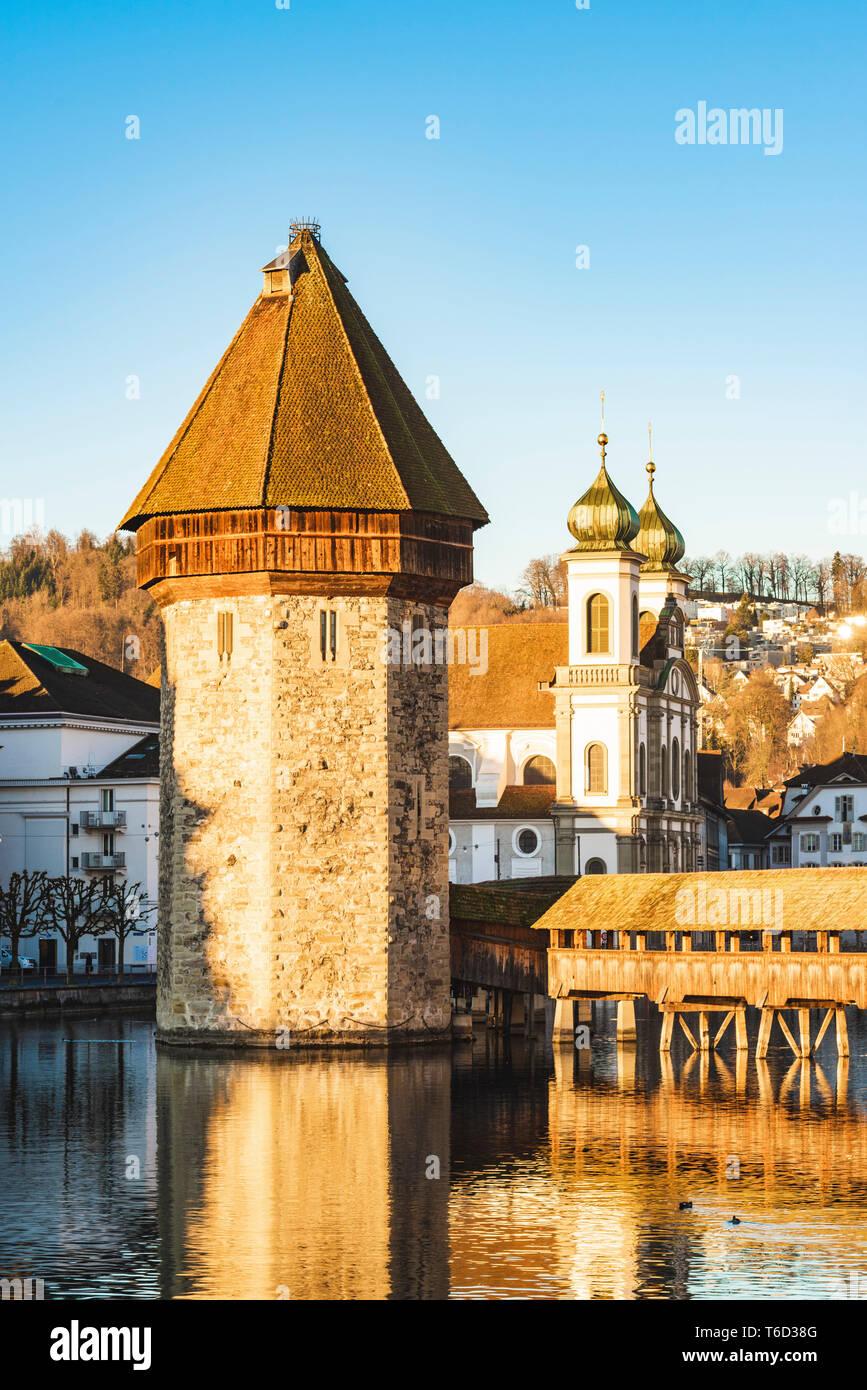 Lucerne, Switzerland. Chapel Bridge's (Kapellbrücke) water tower and Jesuit church - Stock Image