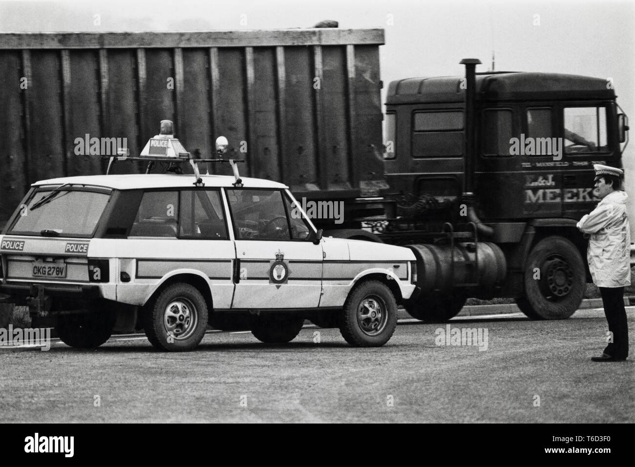 Police block roundabout during 1984 miners strike at Magor Services to allow convoy of lorries through carrying coal & coke bound for Llanwern steelworks Newport South Wales UK - Stock Image