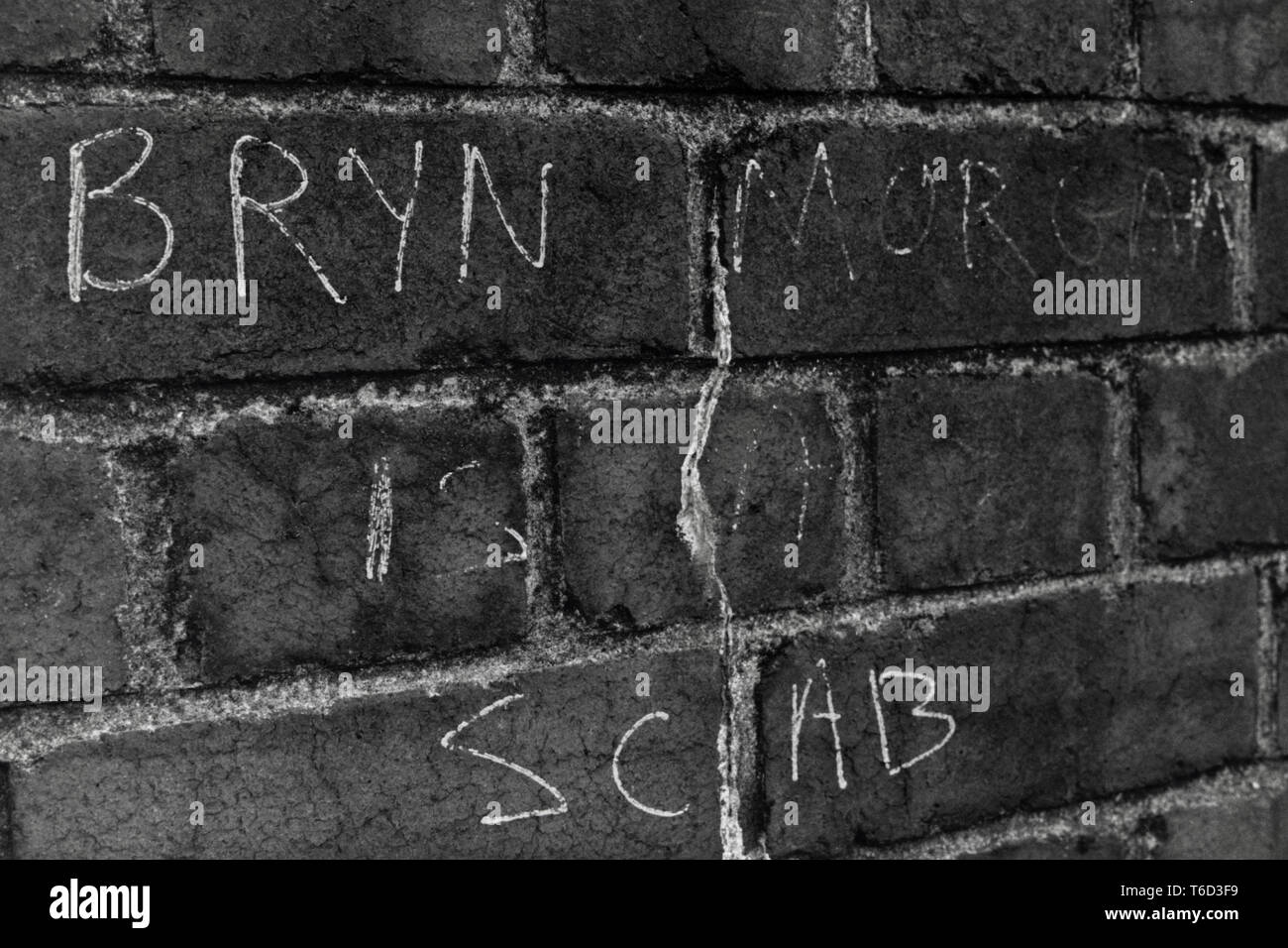 Graffiti on wall in South Wales during 1984 -85 miners strike BRYN MORGAN IS A SCAB - Stock Image