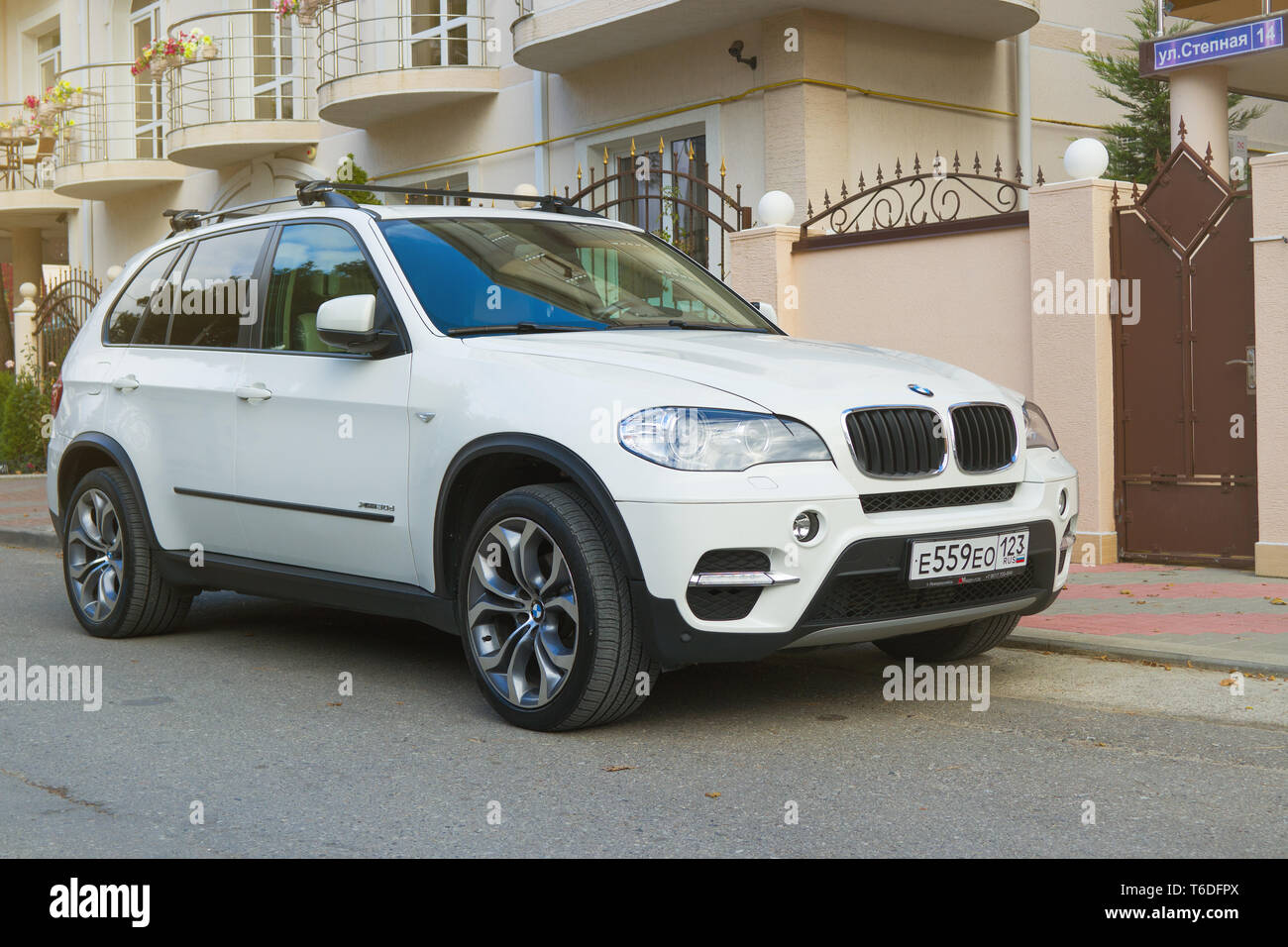 Novorossiisk, Russia - November 26, 2017: New white BMW x5 parked near house in street of the city.  - Stock Image