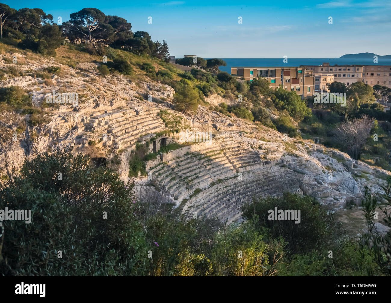 The Roman Amphitheatre of Cagliari, Sardinia, Italy. Built in the 2nd century AD, half carved in the rock of a hill. - Stock Image
