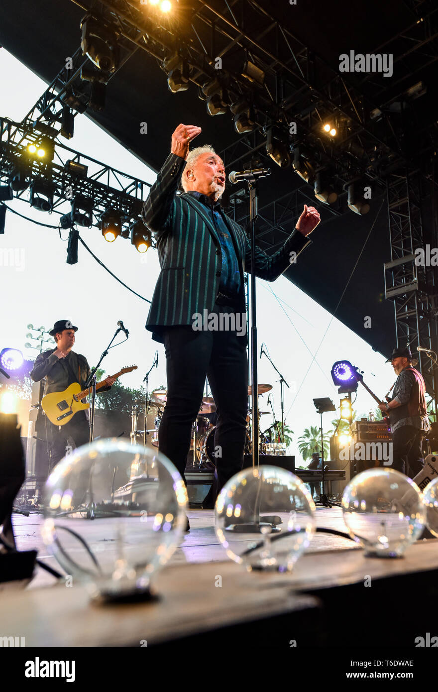 Indio, California, April 28, 2019, Tom Jones on stage performing to an energetic crowd on day 3 of the Stage Coach Country Music Festival. Photo: Ken  Stock Photo