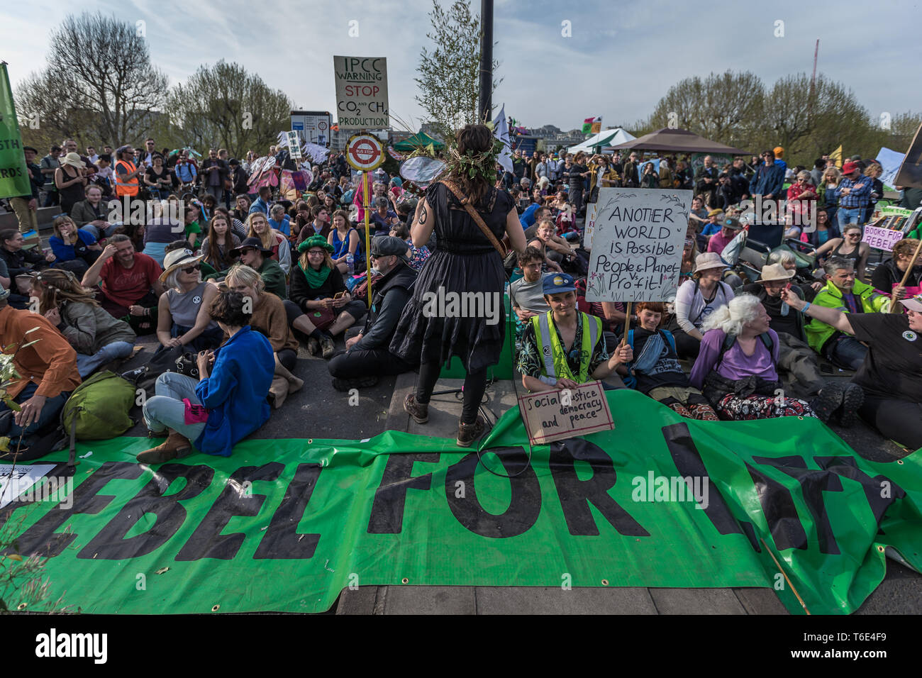 Extinction Rebellion activist seize Waterloo Bridge in London - Stock Image