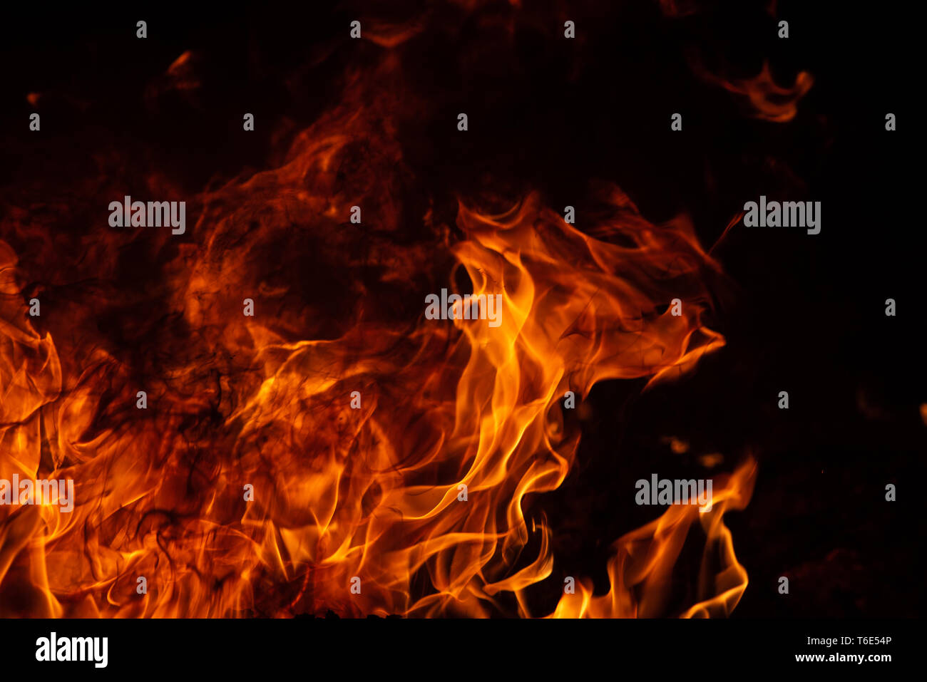 On fire. Themes of fire, disaster and extreme events. Background with copy space for text. - Stock Image